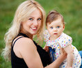 Mother and daughter beautiful having fun outdoors shallow depth of field Royalty Free Stock Photos