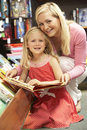 Mother and daughter in bookshop Royalty Free Stock Image