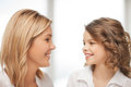 Mother and daughter bright closeup picture of Royalty Free Stock Photography