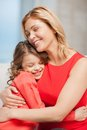 Mother and daughter bright picture of hugging Stock Photo