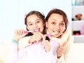Mother and daughter brush their teeth Royalty Free Stock Image