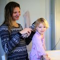 Mother and daughter brushing hair together Royalty Free Stock Photo