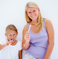 Mother and daughter brushing their teeth Royalty Free Stock Images