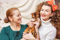 Mother, daughter and a cat. Pet. Royalty Free Stock Photo