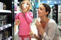 Mother and daughter choose perfume in perfume shop Royalty Free Stock Images