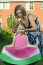 Mother and daughter combing hair Stock Photos
