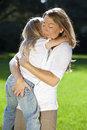 Mother and Daughter Cuddling In A Park Royalty Free Stock Photos