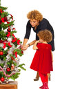 Mother and daughter decorate xmas tree isolated on white background Royalty Free Stock Photos