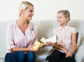Mother with daughter discussing menstruation and sanitary products Royalty Free Stock Photo
