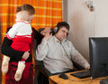 Mother and daughter disturbs  working father Stock Photo