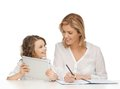 Mother and daughter doing home work Stock Image