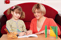Mother and daughter doing homework happy Stock Photos