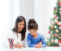 Mother and daughter drawing family children christmas x mas happy people concept Royalty Free Stock Photo