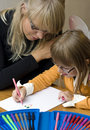 Mother and daughter drawing together Stock Images