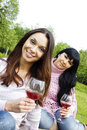 Mother and daughter drinking wine outdoors Royalty Free Stock Image