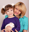 Mother and daughter with dwarf bunny Royalty Free Stock Images
