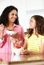 Mother and daughter eating cereal and fruit Stock Image