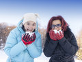 Mother and daughter eating snow Royalty Free Stock Photos