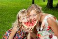 Mother and daughter eating watermelon Stock Images