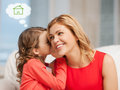 Mother and daughter with eco house Royalty Free Stock Photos