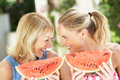Mother And Daughter Enjoyin Water Melon Royalty Free Stock Photo