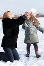 Mother and  daughter enjoying beautiful winter day Stock Photos