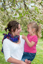 Mother and daughter enjoying a funny moment while taking a walk in the park in spring Royalty Free Stock Photo