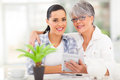 Mother daughter finances happy senior helping calculate her Stock Photo
