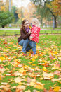 Mother and daughter gathering leaves autumn Royalty Free Stock Photography