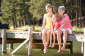 Mother,daughter and grandmother sat by lake Royalty Free Stock Photo