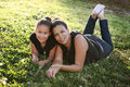 Mother and daughter on the grass at a park Stock Photography