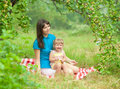 Mother and daughter have picnic outdoor Royalty Free Stock Image