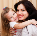 Mother and daughter having fun at home young with playing family portrait Stock Photography