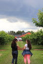 Mother and Daughter having Fun Picking Cherries Royalty Free Stock Photo
