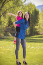 Mother and daughter having fun together outdoors a portrait of a cute little girl her Royalty Free Stock Photo