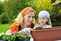 Mother and daughter having gardening time Stock Image
