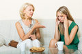 Mother with daughter having serious conversation mature adult Stock Image