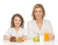 Mother and daughter with healthy unhealthy food Royalty Free Stock Photos