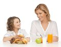 Mother and daughter with healthy unhealthy food Stock Photos