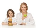 Mother and daughter with healthy unhealthy food Stock Images