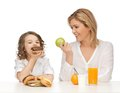 Mother and daughter with healthy unhealthy food Royalty Free Stock Image
