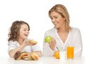 Mother and daughter with healthy unhealthy food Royalty Free Stock Photography