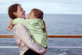Mother daughter hugging on deck of ship Stock Photos