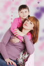 Mother and daughter hugging pink decoration Royalty Free Stock Photo