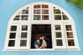 Mother and Daughter Kissing at Colmar Tropicale French Building in Malaysia Stock Photo