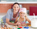 Mother and daughter Kitchen Smiling at Camera Royalty Free Stock Photo