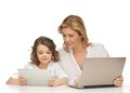 Mother and daughter with laptop tablet pc Royalty Free Stock Photo