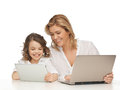 Mother and daughter with laptop tablet pc Royalty Free Stock Photos