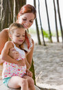 Mother and daughter listening to seashell Royalty Free Stock Photo