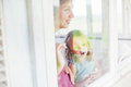 Mother and daughter looking through the window Royalty Free Stock Photo